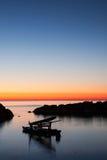 Pedalo amarró en el mar en el amanecer Fotografía de archivo