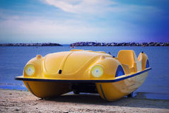 Pedalo on the beach. A yellow pedalo on a beach in Rimini, Italy Royalty Free Stock Photography