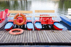 Pedalo on lake and life buoy. Colorful pedalo on resort lake and life buoy Royalty Free Stock Photos