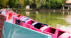 A pedalo or paddle boat is a small human-powered watercraft propelled by the action of pedals turning a paddle wheel. Royalty Free Stock Photos