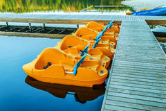 Pedalo or paddle boat. A pedalo or paddle boat is a small human-powered watercraft propelled by the action of pedals turning a paddle wheel Stock Photography