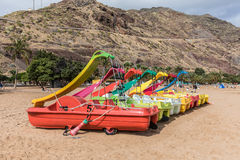 Pedalo with playground slide on the beach Royalty Free Stock Photo