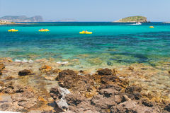 Pedalos on the bech. Sea scene with four yellow pedalos royalty free stock photos