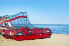 Pedalos boats on the beach. Red pedalos boats on the beach. Costa Brava, Spain stock photos