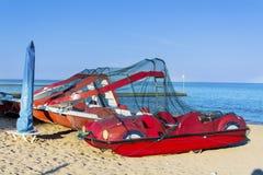 Pedalos boats on the beach. Red pedalos boats on the beach. Costa Brava, Spain stock photo