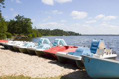 Pedalos boats in the sand. In front of a lake in a sunny day royalty free stock images