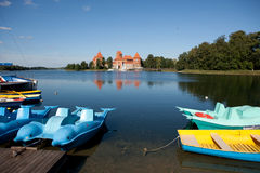 Pedalos and boats in Trakai Royalty Free Stock Images