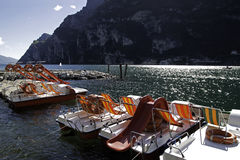 Pedalos in Garda lake, Italy Royalty Free Stock Image