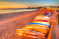 Pedalos Goodrington beach near Paignton Devon England with huts colourful HDR. Pedalos Goodrington beach near Paignton Devon England with huts on a summer Royalty Free Stock Photo