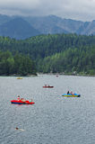 Pedalos in the mountain lake Eibsee Royalty Free Stock Image