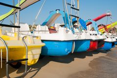 Colorful pedalos next to each other. Pedalos on the sandy shoreline of the sandy beach stock photography