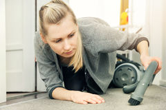 Pedantic woman cleaning house with vacuum cleaner Royalty Free Stock Photos