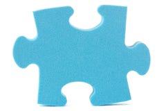 Pedazo azul del rompecabezas Foto de archivo