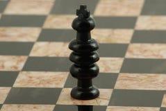 Pedazo de ajedrez, rey negro imagenes de archivo