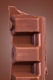 Pedazo de la barra de chocolate Imagenes de archivo