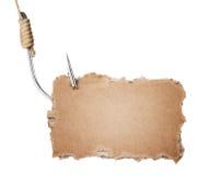 Pedazo de la cartulina en el gancho de leva de pesca Foto de archivo