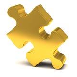 Pedazo de los rompecabezas del oro Foto de archivo libre de regalías