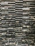 Pedazo de mármol negro con el modelo y la textura naturales en la pared para el trabajo de arte del fondo o del diseño Imagen de archivo