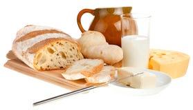 Pedazo de mantequilla, de pan y de un cuchillo fotografía de archivo libre de regalías