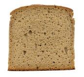Pedazo de pan aislado en blanco Imagenes de archivo