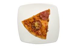 Pedazo de pizza italiana en la placa Imagenes de archivo