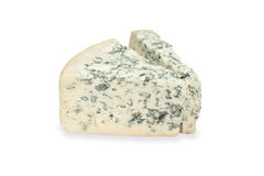 Pedazo de queso verde en el fondo blanco Imagen de archivo libre de regalías