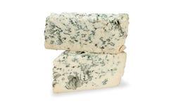 Pedazo de queso verde en el fondo blanco Imágenes de archivo libres de regalías
