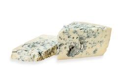Pedazo de queso verde en el fondo blanco Foto de archivo libre de regalías