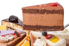 Pedazo de torta con soplo del café Imágenes de archivo libres de regalías