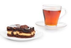 Pedazo de torta con té Foto de archivo libre de regalías