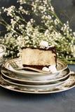 Pedazo de torta con un soplo Fotos de archivo