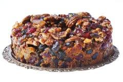 Pedazo de torta deliciosa de la fruta y de la tuerca Fotografía de archivo libre de regalías