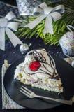 Pedazo de torta en el Año Nuevo Imagenes de archivo