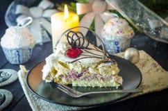 Pedazo de torta en el Año Nuevo Foto de archivo