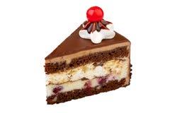 Pedazo de torta en un fondo blanco fotografía de archivo