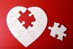 Pedazo del rompecabezas del corazón Fotos de archivo libres de regalías