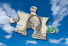 Pedazo del rompecabezas del dinero Imagen de archivo libre de regalías