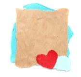 Pedazo desigual de papel viejo con el corazón Fotos de archivo