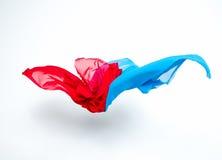 Pedazos abstractos de vuelo azul y rojo de la tela Imágenes de archivo libres de regalías