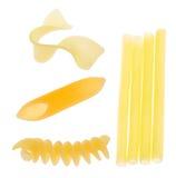 Pedazos amarillos de colección de los macarrones aislados en blanco Fotos de archivo