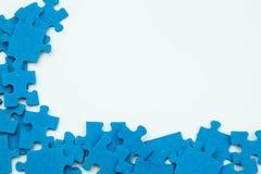 Pedazos azules del rompecabezas Fotografía de archivo libre de regalías