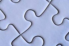 Pedazos conectados de rompecabezas Imagen de archivo libre de regalías