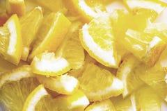 Pedazos cortados en trozos pequeños de limón Imágenes de archivo libres de regalías