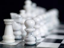 Pedazos de ajedrez blancos Imagen de archivo libre de regalías