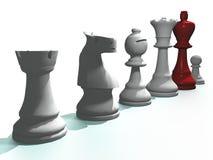 Pedazos de ajedrez con el rey rojo Foto de archivo libre de regalías