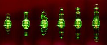 Pedazos de ajedrez encendidos verde Imagen de archivo libre de regalías