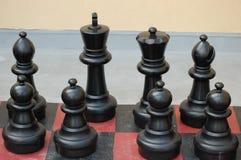 Pedazos de ajedrez negros Foto de archivo