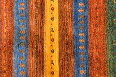 Pedazos de alfombras modeladas coloridas como fondos Imagenes de archivo