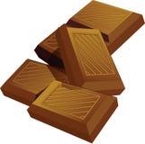 Pedazos de barra de chocolate Foto de archivo libre de regalías