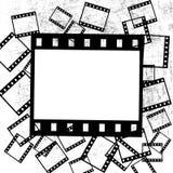 Pedazos de la película en fondo del grunge Fotografía de archivo libre de regalías